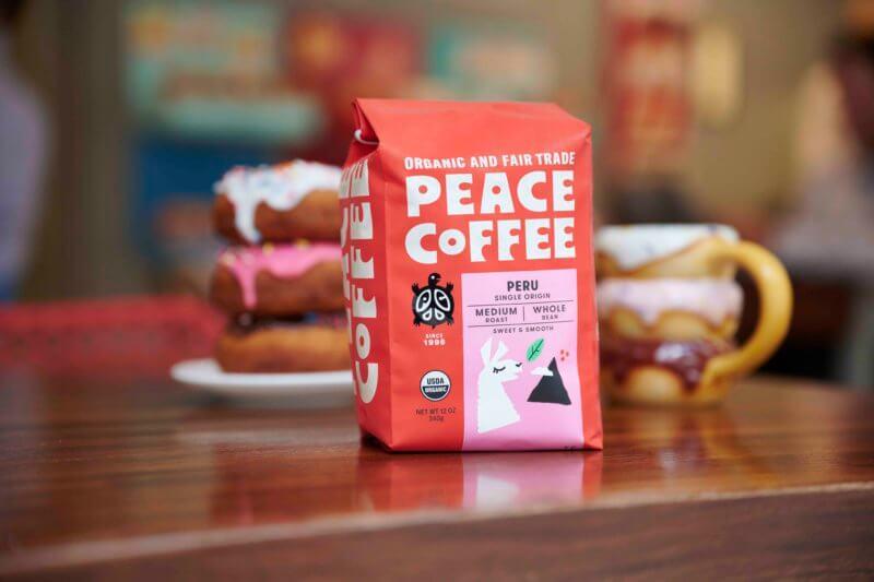 organic peruvian coffee with donuts and a mug