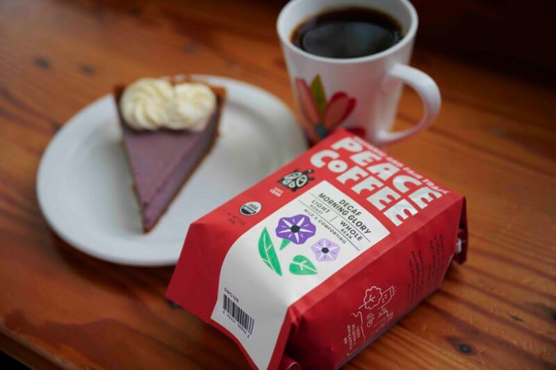 a mug of light roast decaf coffee with pie