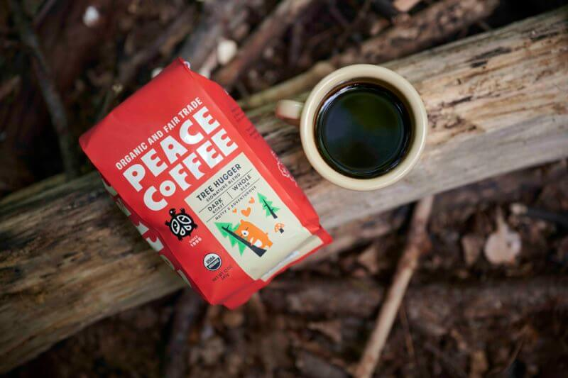 a bag of organic dark roast coffee in the woods