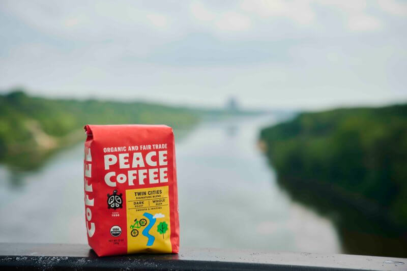 a bag of fair trade dark roast coffee by the river