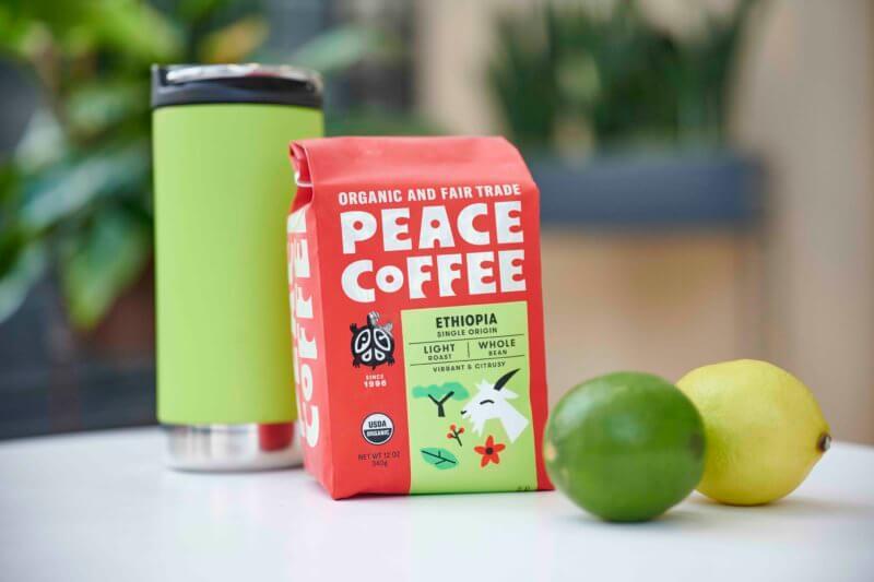 a bag of ehtiopia light roast organic coffee with travel mug