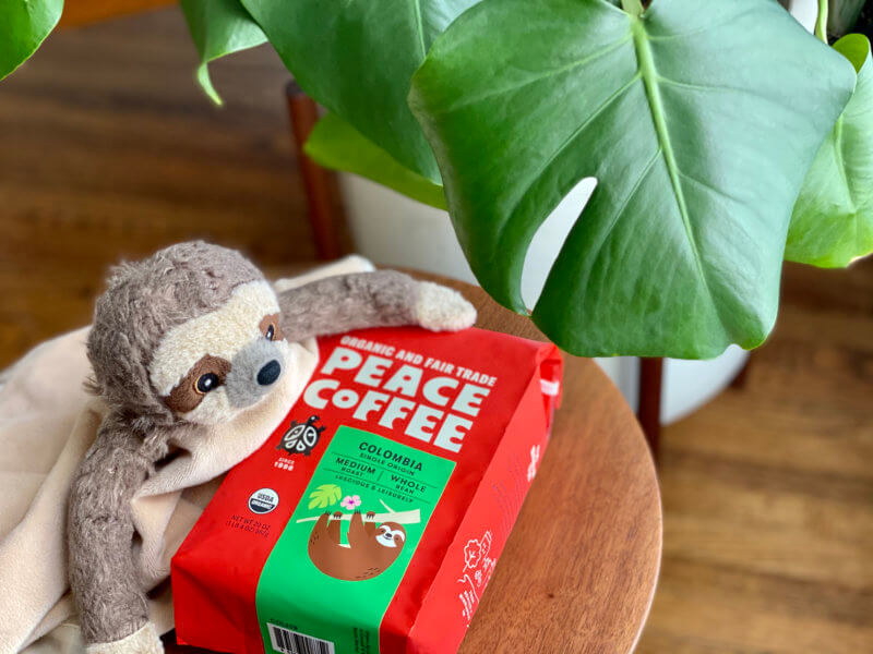 bag of Colombia Single Origin with a furry sloth