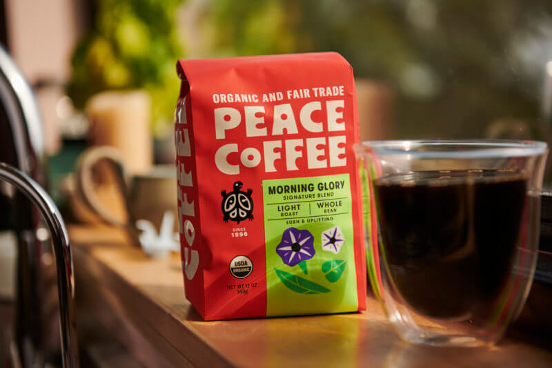 fair trade light roast coffee with a mug of brewed coffee